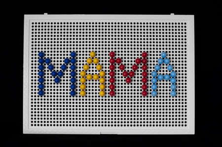 Text Mama on child mosaic. Colorful mosaic pieces photo