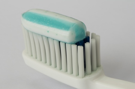 Toothbrush and toothpaste on top. Very close up photo