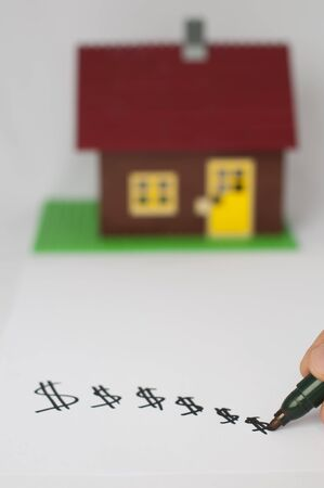 Hand write dollar symbols and house on background. Real estate conception Stock Photo - 11690150