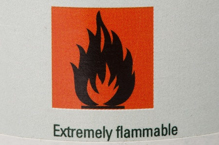 symbol flammable: Symbol for flammable liquids on pressure bottle Stock Photo
