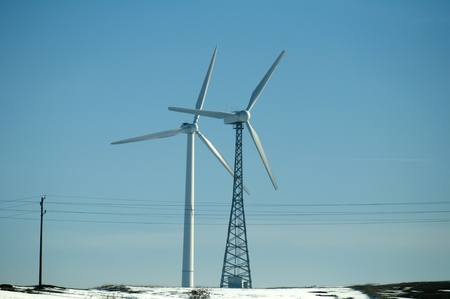 Two wind generators in winter time photo