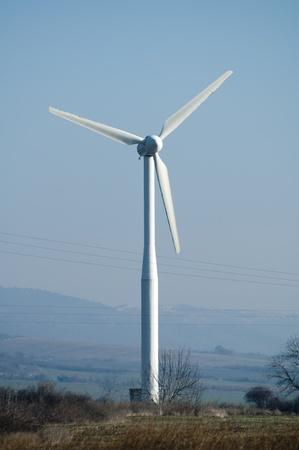 Wind generators on blue sky. photo