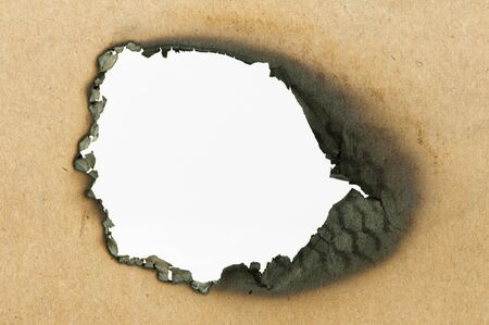 Burned paper and close up hole photo