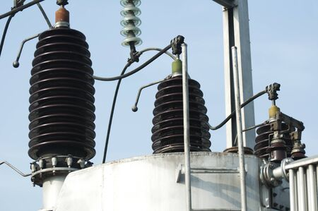 High-voltage wires and transformers. Electrical distribution station photo