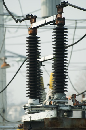 pylons: High-voltage wires and transformers. Electrical distribution station