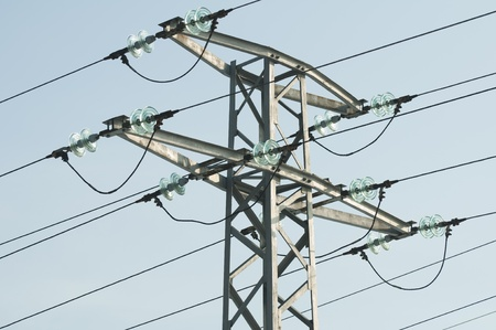 High voltage poles and wires on blue sky Stock Photo - 11857339