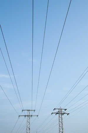 High voltage poles and wires on blue sky Stock Photo - 11857299