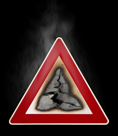 Warning sign fire hazard with smoke. Black isolated Stock Photo - 11936856