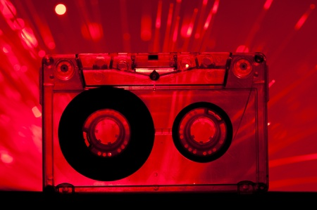 analogical: Transparent Cassette tape and red color disco lights background Stock Photo