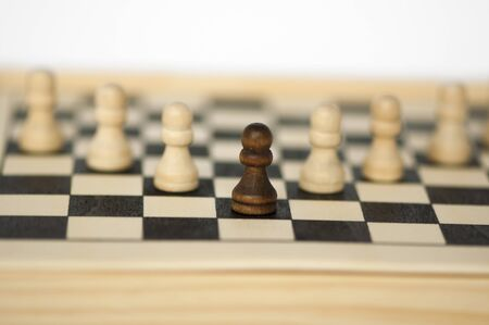 Concept of uniqueness and leadership with chess figures photo