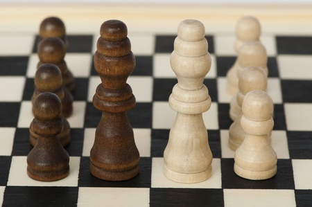 Concept of battle and victory with chess figures photo