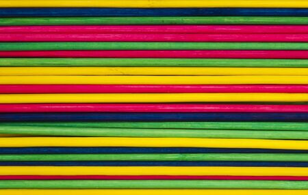 Colorful background with colored sticks photo