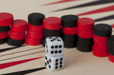 backgammon: Black and red Backgammon and dices. Success conception Stock Photo