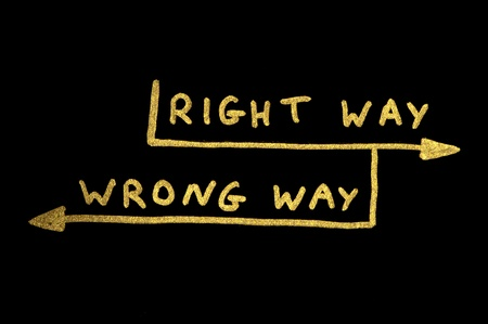 Wrong way and right way conception texts over black photo