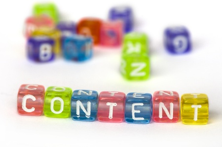 Text Content on colorful wooden cubes over white Stock Photo - 12322617