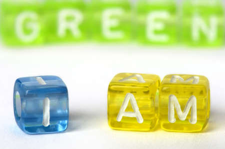 Text I am green on colorful cubes over white photo