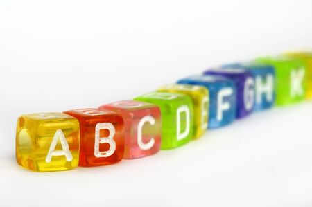 Text A B C on colorful wooden cubes over white photo