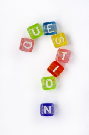Text nd sign question on colorful cubes over white photo