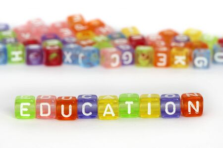 Text Education on colorful wooden cubes over white photo