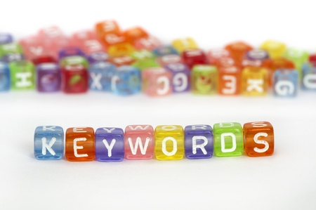 Text Keywords on colorful cubes over white. Randomly scattered cubes on background