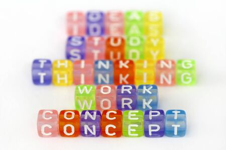 Text Concept on colorful cubes over white. Texts study, work, thinking and idea blurred on background Stock Photo - 12319867