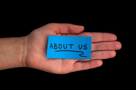 about us: Word About us on blue paper and hand