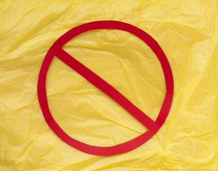 Yellow paper and red prohibition sign.  photo