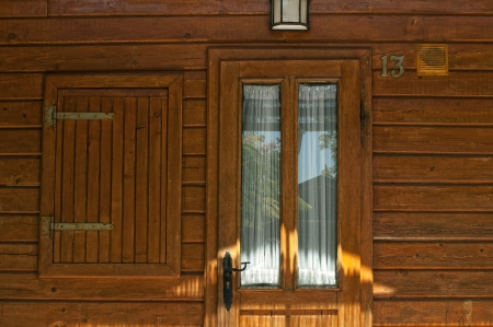 Wooden bungalow door and window photo