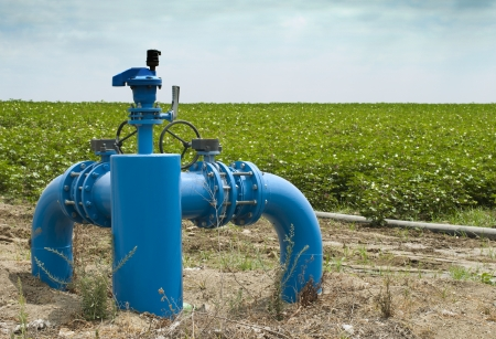 irrigated: Irrigation systems, pipes and faucets for watering. Stock Photo