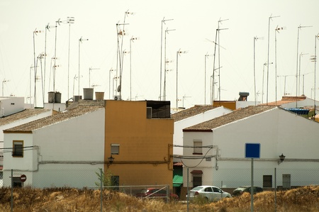 Houses and antennas on the roof photo