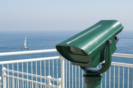 Green tourist telescope. Sea view and sky photo