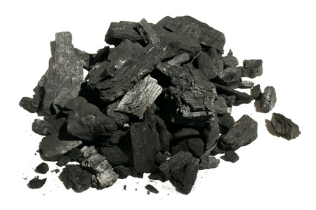 Natural charcoal close up. White isolated Stock Photo