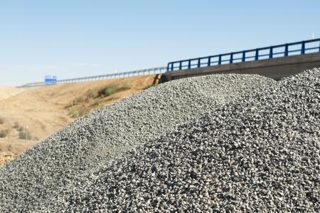 asphalting: Asphalt and asphalting the road. Close up