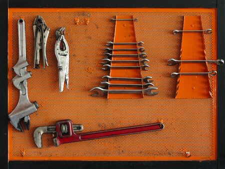 Tools for Car arranged on the wall photo