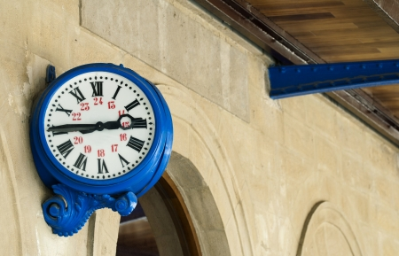 Antique external blue clock on  railway station photo