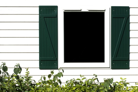 Window with wooden shutters. Isolated copyspace Stock Photo - 15818139