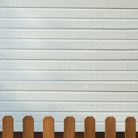 Wooden decorative fence and white wall photo