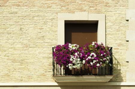 Classic balcony with flowers .