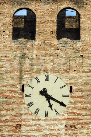 Antique clock on a building. Ancient brick wall photo