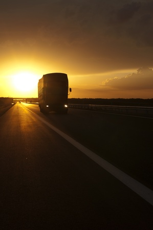 moving truck: Truck traveling at sunset