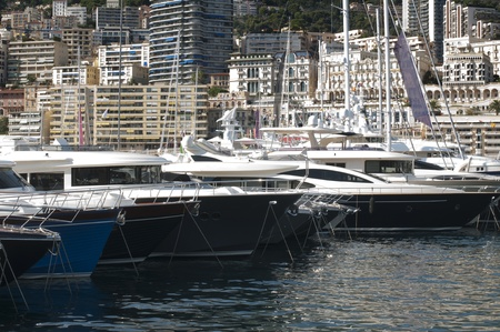 Yachts moored in Monaco. Buildings from Monaco in the background. Stock Photo - 16067070