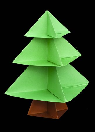 Christmas tree made of paper. Origami evergreen tree photo