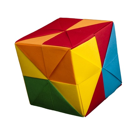 Paper made multi colored patterned cubes folded origami style. Stock Photo