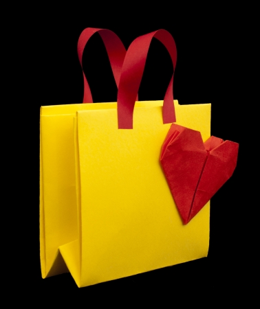 Yellow and red shopping bag with red heart. photo