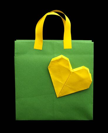 Yellow and green shopping bag with yellow heart. photo