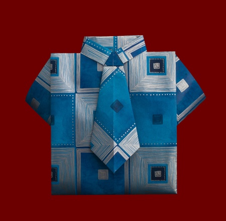 origimi: Isolated paper made blue shirt with ornaments.Folded origami style