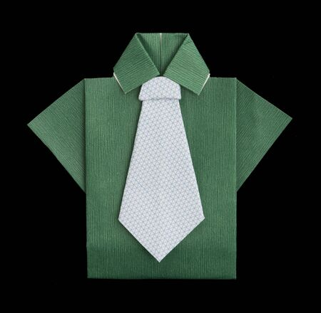 origimi: Isolated paper made green shirt with white tie.Folded origami style Stock Photo
