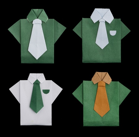 Set of isolated paper made green and white shirts..Folded origami style photo