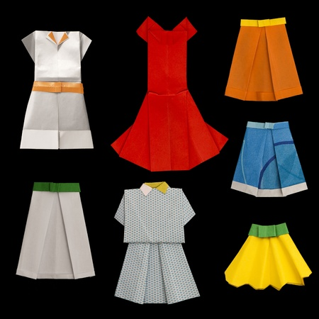 Set of Dresses and Skirts made ​​of paper. Isolated origami photo