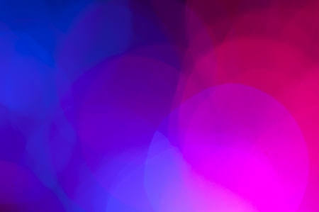 Blue and pink festive lights and circles background photo